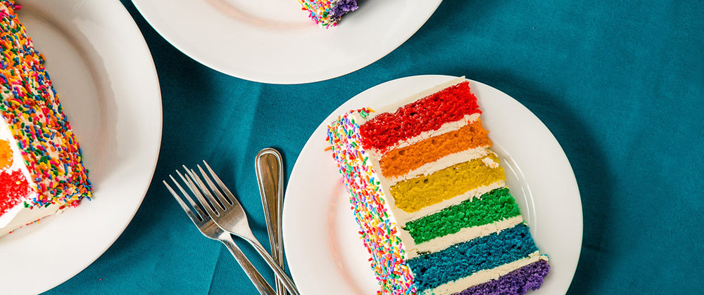 Photo of rainbow colored slices of cake
